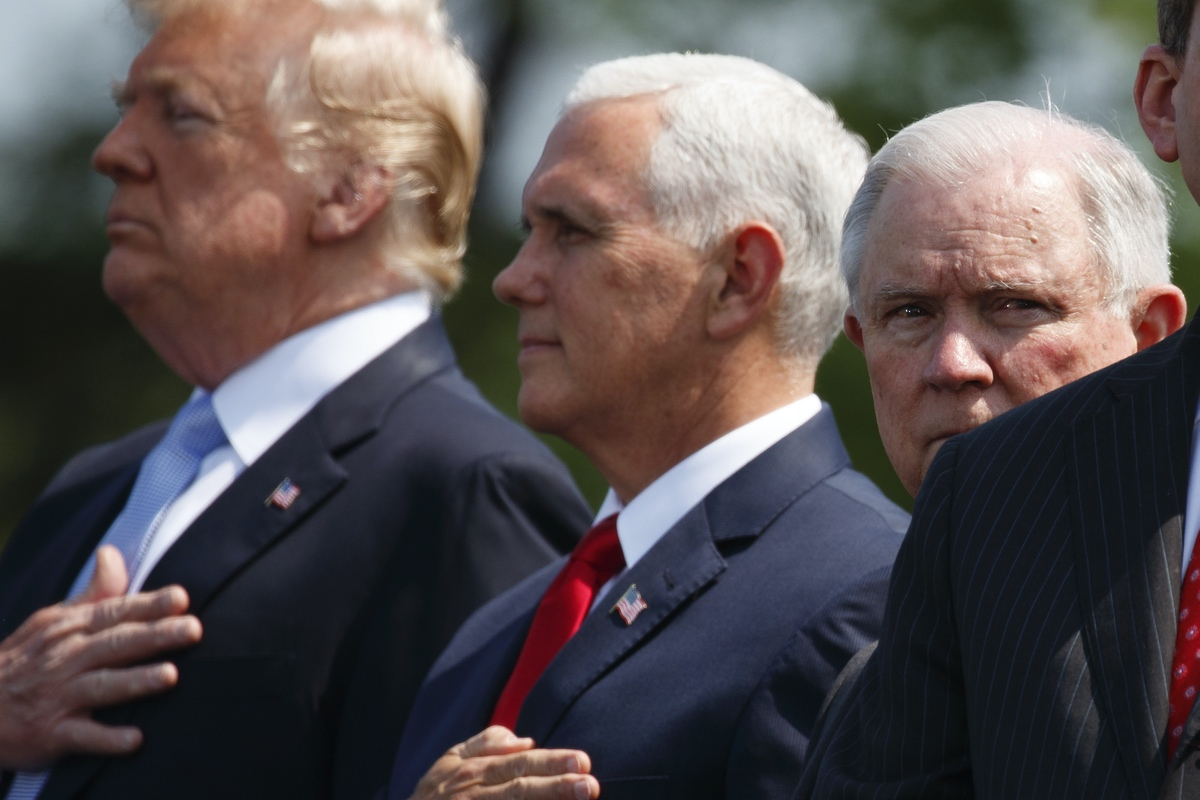 President Donald Trump, Vice President Mike Pence, and Attorney General Jeff Sessions stand for the national anthem during the 37th annual National Peace Officers Memorial Service on Capitol Hill, Tuesday, May 15, 2018, in Washington. (AP Photo/Evan Vucci)