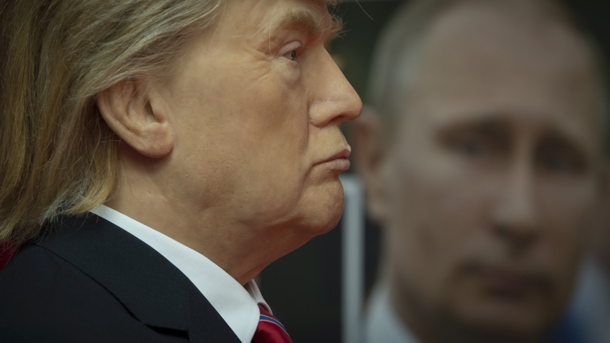 Wax model of US President Donald Trump, left, stands near to a portrait of Russian President Vladimir Putin, displayed in the wax museum in Sofia, Friday March 31, 2017. (AP Photo/Valentina Petrova)