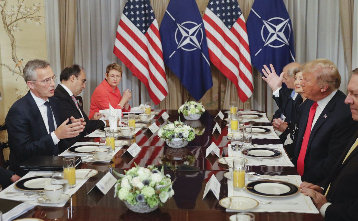 U.S. President Donald Trump, right, and NATO Secretary General Jens Stoltenberg, left, both gesture during their bilateral breakfast, Wednesday July 11, 2018 in Brussels, Belgium. (AP Photo/Pablo Martinez Monsivais)