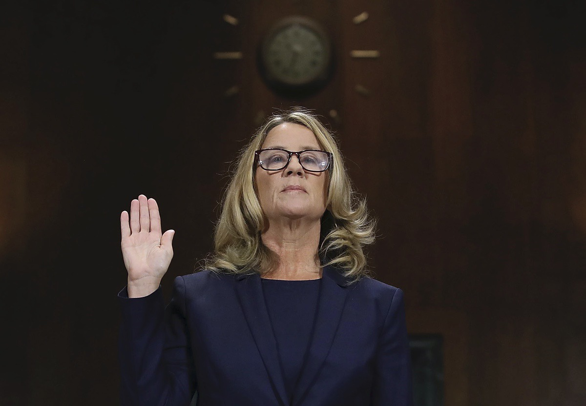 Christine Blasey Ford is sworn in before the Senate Judiciary Committee, Thursday, Sept. 27, 2018 in Washington. Her attorney's Debra Katz and Michael Bromwich watch. (Win McNamee/Pool Image via AP)