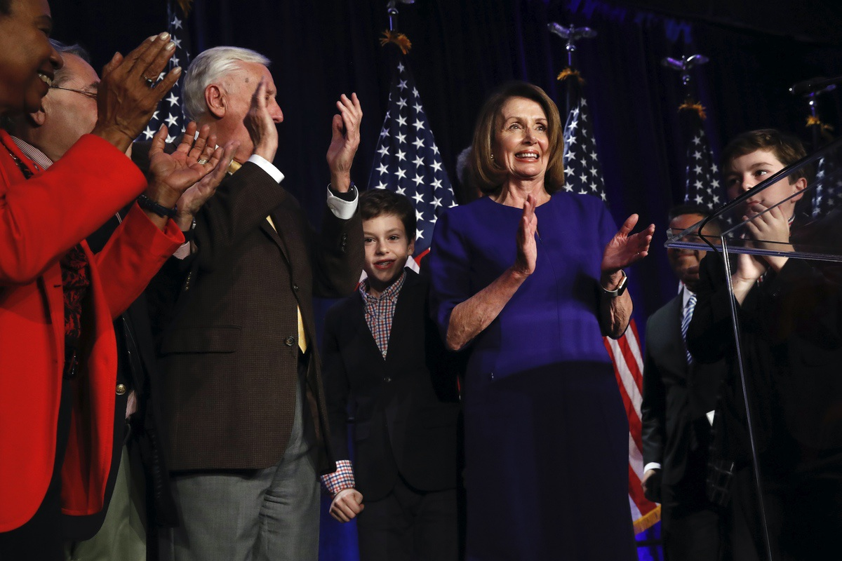 House Democratic Leader Nancy Pelosi of Calif., right, claps between her two grandsons on stage with House Democrats after speaking about Democratic wins in the House of Representatives to a crowd of Democratic supporters during an election night returns event at the Hyatt Regency Hotel, on Tuesday, Nov. 6, 2018, in Washington. (AP Photo/Jacquelyn Martin)